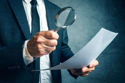 man using magnifying glass
