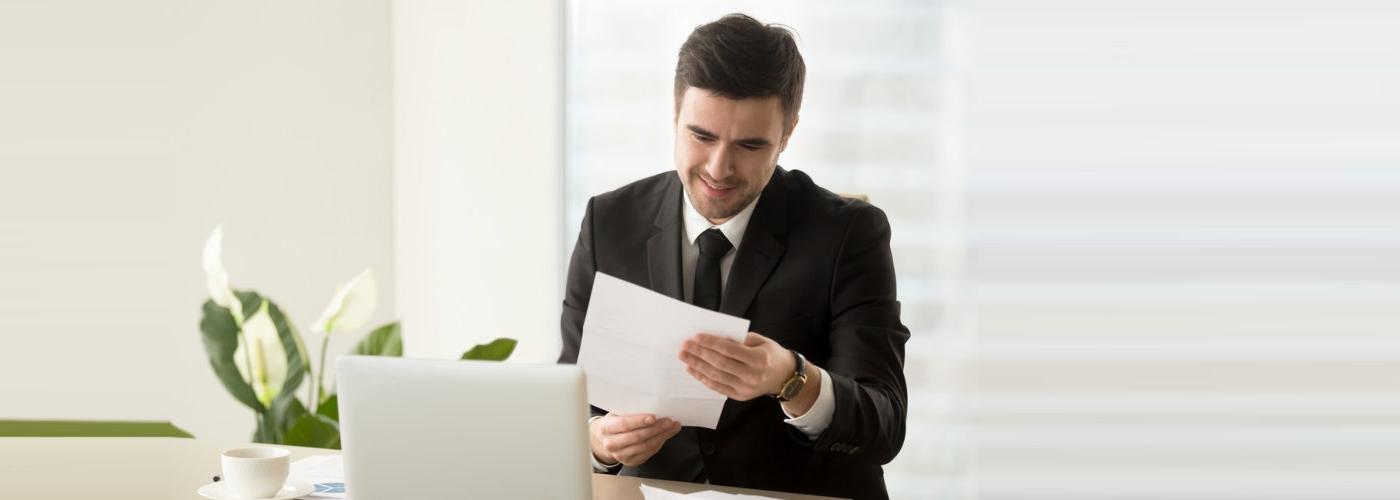 man looking at paper
